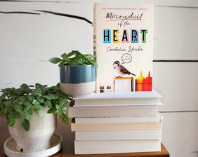 book display with plants, misconduct of the heart
